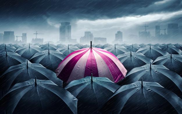 pink-white-umbrella-with-dark-stormy-clouds_104033-44